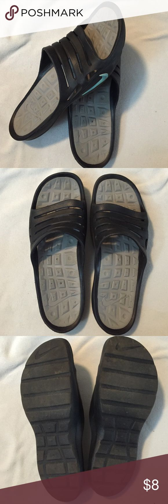 Nike Sandal This pair of Nike sandals are black with light blue nike swoosh. They have light wear. Make an offer! Nike Shoes Sandals
