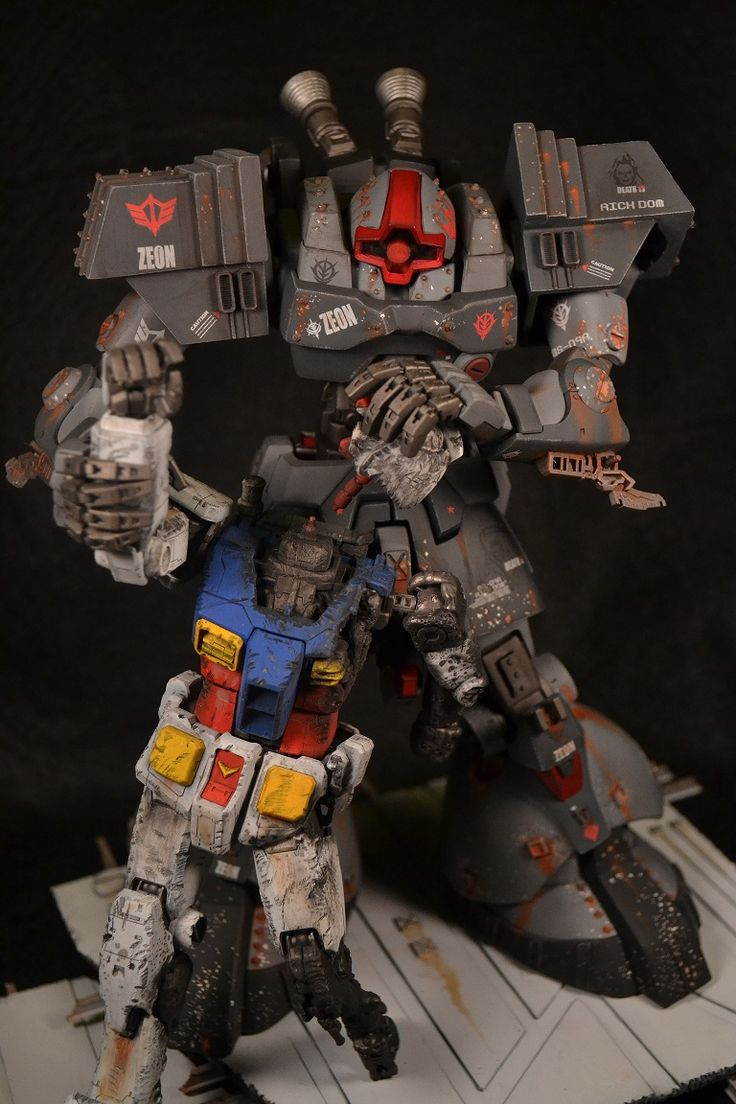 Gunpla giant Dom ripping the RX-78-2 gundams head off. so cool yet disturbing