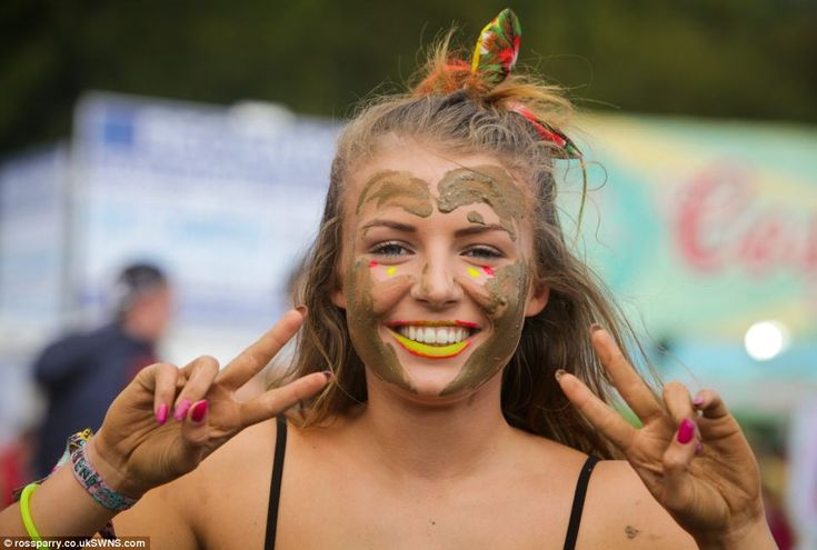 Olivia Crossland, 17, from Barnsley makes the most of the mud at Leeds Festival adding it ...