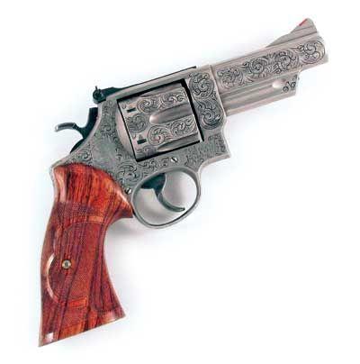 Custom Jim Riggs-engraved checkered Culina grips in the Roper pattern S&W Model 29 .44 magnum 6-shot DA/SA revolver https://en.wikipedia.org/wiki/Smith_%26_Wesson_Model_29