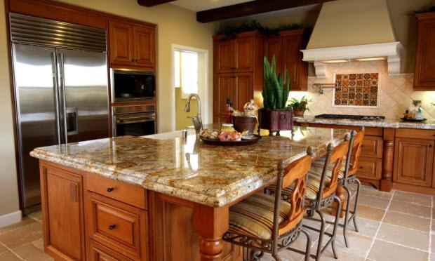 Light oak kitchen cabinets with granite