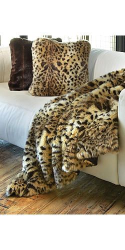 Get cozy with these leopard throw pillows and blanket. #Jerseylicious #FinaleParty #Inspiration