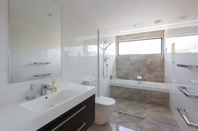 A large, spacious light-filled bathroom.
