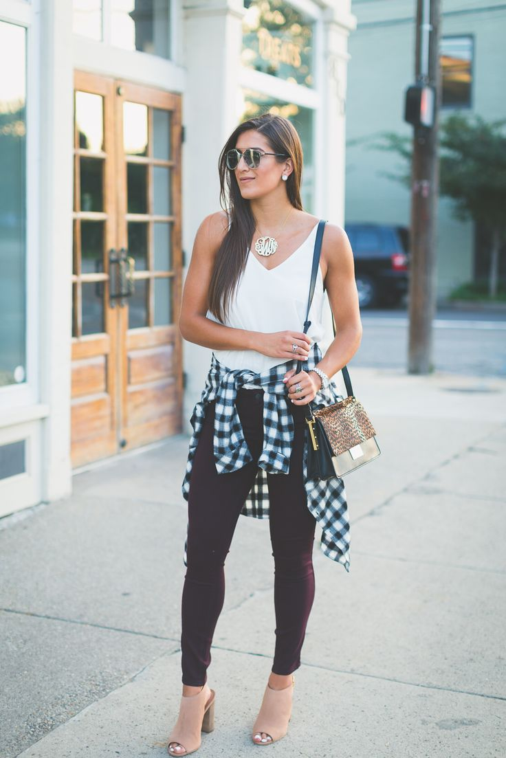 white tank, black and white buffalo plaid button-down shirt, dark cranberry skinny jeans, tan open-toe booties