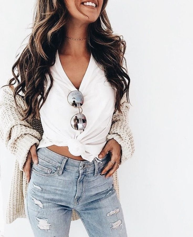 Comfy beige cardigan over white knotted tee and distressed denim jeans.