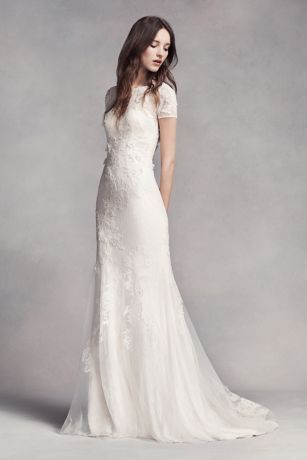 Effortlessly chic and modern. This veiled lace short sleeve sheath wedding dress is thoughtfully detailed with corded lace and delicate organza flowers. A bias-cut charmeuse slip is layered underneath.  White by Vera Wang, exclusively at David's Bridal  Polyester  Sweep train  Back zipper; lined  Dry clean  Imported