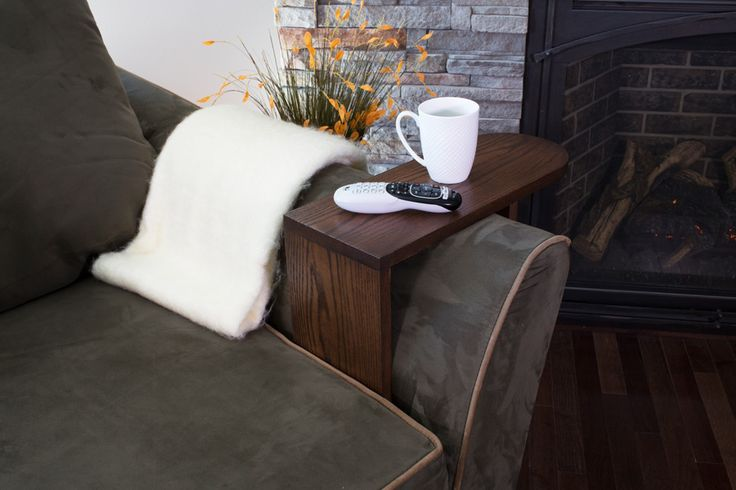 """Here's the perfect place to park your beverage, snacks, remotes; anything you want close at hand while you're relaxing on the couch. It's a """"table,"""" made from just three boards, that straddles the arm of your favorite sofa or chair."""