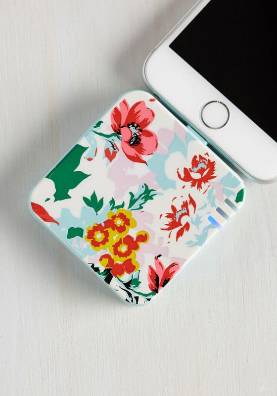 LOVE this floral portable battery charger: great tech gift for any traveler. (Or anyone who uses their phone for photos, checking email or...yeah. Everything)