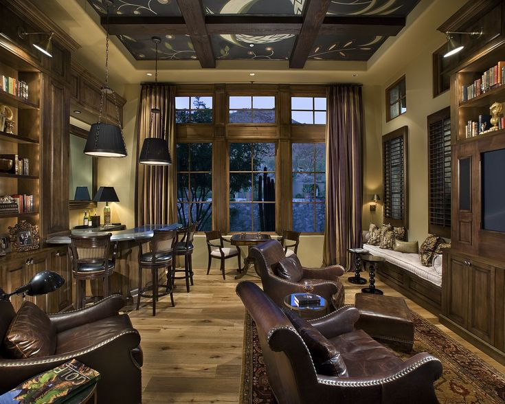 Beautiful Den With Wood Built Ins Leather Furniture, And Bar Area.
