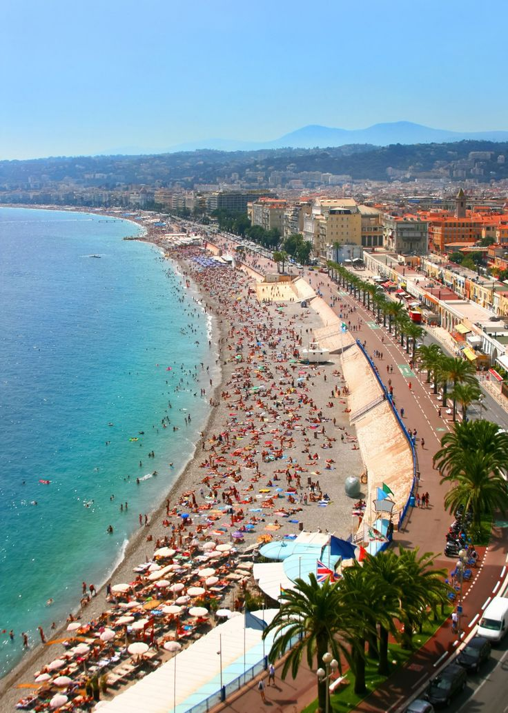 the crowded beach of nice french riviera traveltheworld pinterest resorts nice and read more. Black Bedroom Furniture Sets. Home Design Ideas