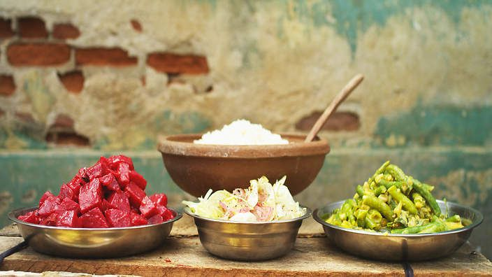 Peter Kuruvita's beetroot curry with snake bean curry. Watch the video recipe.