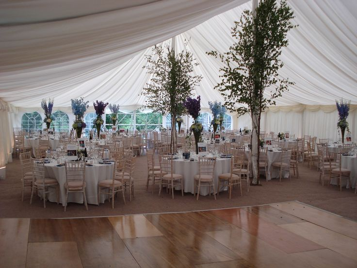 Bringing the outside in, a beautiful feature of the support poles in a Traditional marquee.