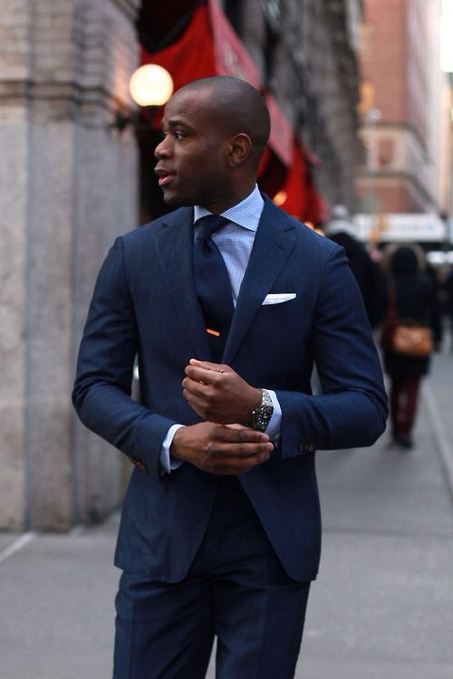 Blue suit, blue/white striped shirt, blue tie and orange ...