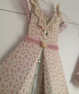 The 'Mary-Jane' Can purchase on Etsy Handmade origami dresses - great gifts sold as individuals and in packages, come with rustic twine, miniature pegs for hanging and decoupaged self-adhesive pegs to mount 'clothesline' for display