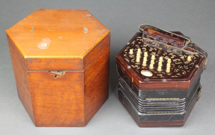 Lot 320, A Lachenal & Co concertina with 33 buttons, paper label marked Lachenal & Co, Patent Concertina Manufacturers London. 93020, complete with original mahogany carrying box, est  £300 - 500