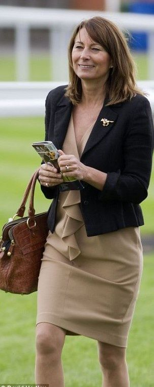 Prince William's mother-in-law Carole Middleton proved that her daughters' enviable sense of style runs in the family with a smart ensemble that was perfectly chosen for the occasion.  She topped off the ensemble with a brown crocodile skin effect handbag and, in the spirit of the equestrian occasion, a shiny gold racehorse brooch.