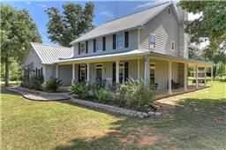 One acre country home in the heart of Coldspring but close to Lake Livingston. 120 Moore St, Coldspring TX  77331