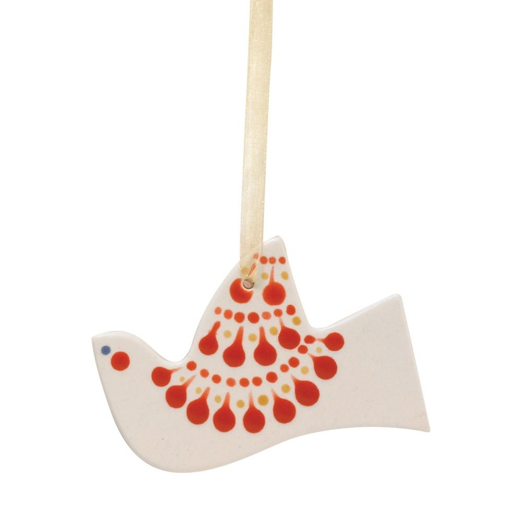 Deck your halls with this beautiful hand-painted ceramic ornament in a classic red and white design.