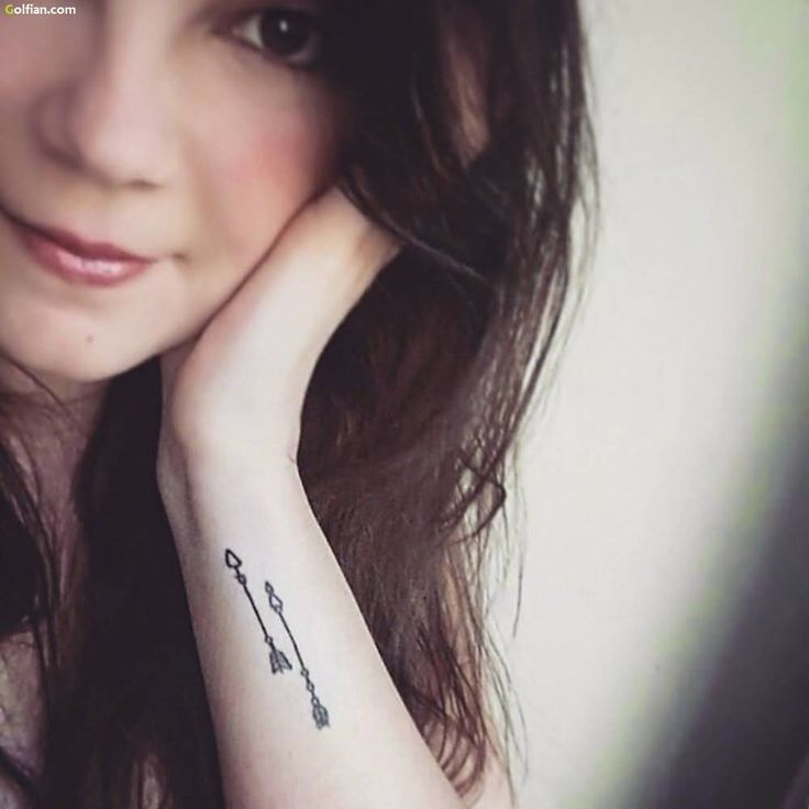 Impressive Two Arrows Tattoo On Wrist For Girl