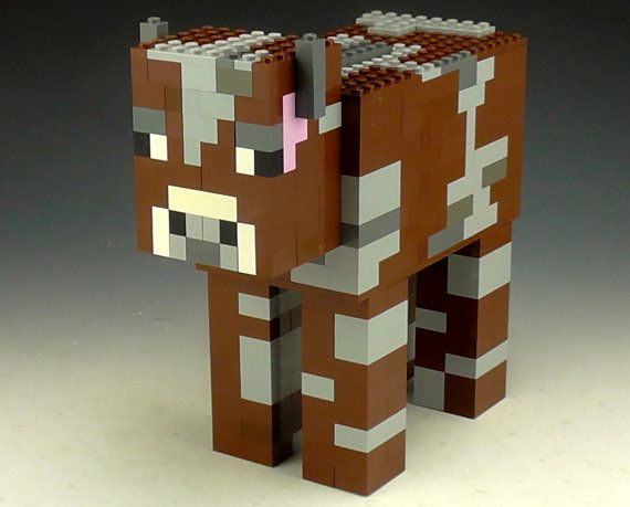 This is a Lego Minecraft Cow used with white, grey, dark grey, brown, pink and black bricks. This Lego Minecraft Cow is 8 inches long, 8 inches tall and