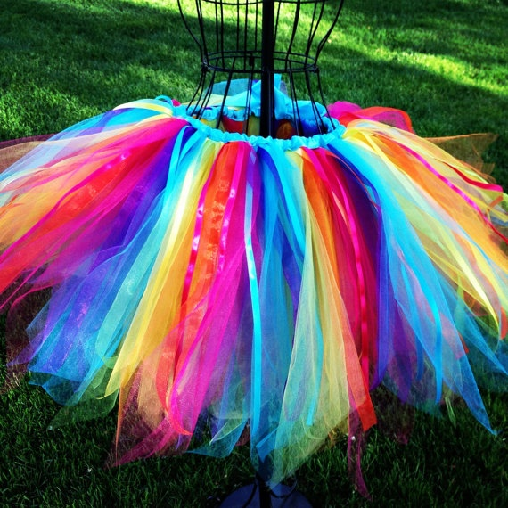 ADULT RAINBOW TUTU- A lovely long rainbow tutu for costumes, festivals, or any old day. Sewn and machine washable. $75.00, via Etsy.