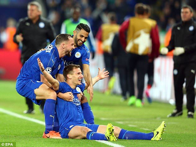 Marc Albrighton is mobbed by his team-mates after scoring the Foxes' second goal