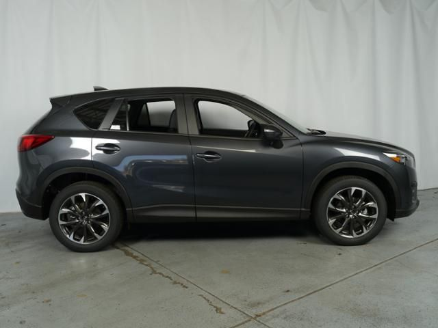New 2016 Mazda Mazda CX-5 for sale in Brooklyn Center MN at Luther Brookdale Mazda deler Minnesota. 2016 CX-5 for sale Minneapolis, Golden Valley, Plymouth, Bloomington MN. Mazda crossover SUV for sale. New CX-5 in Meteor Gray Mica for sale. Minnesota. Key features: Leather Seats, Premium Sound System, Satellite Radio, Power Tilt/Sliding Sunroof, Heated Driver Seat. AWD SUV. All-Wheel Drive. - Every Mazda has the soul of a sports car. New Mazda for sale near Minneapolis, Minnesota.