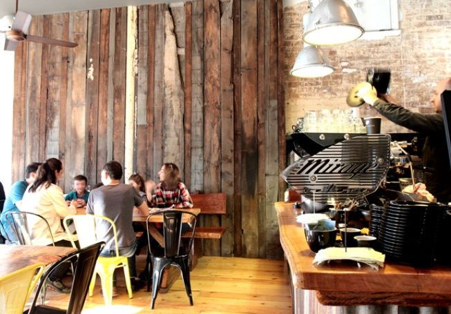 Gorgeous recycled timber feature wall and eclectic seating. Lusting after that Mirage espresso machine! Lyons Raw, Sydney.