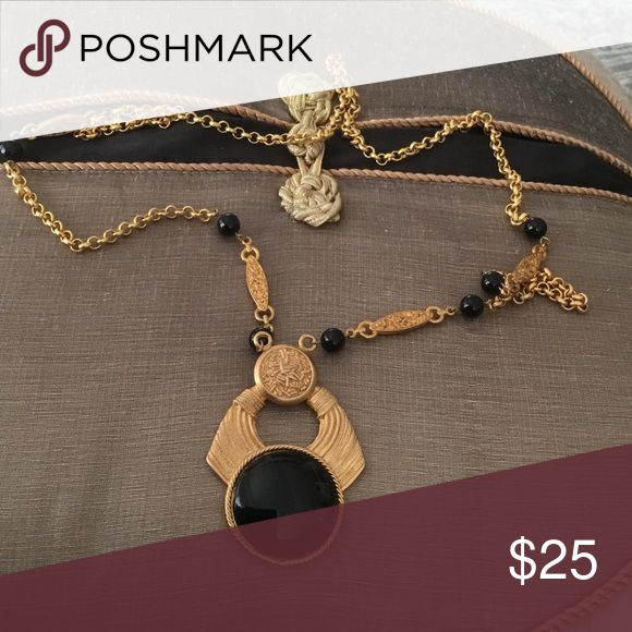 """CHICOS necklace Very Egyptian looking gold necklace with black beads in between some links and a 3"""" pendant with a large 1 1/2 """" black stone. This is antique looking. Chico's Jewelry Necklaces"""