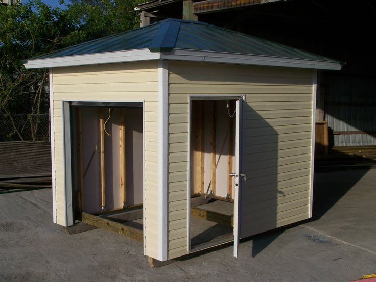 This Shed Has A Roll Up Door And Also A Side Entry Door