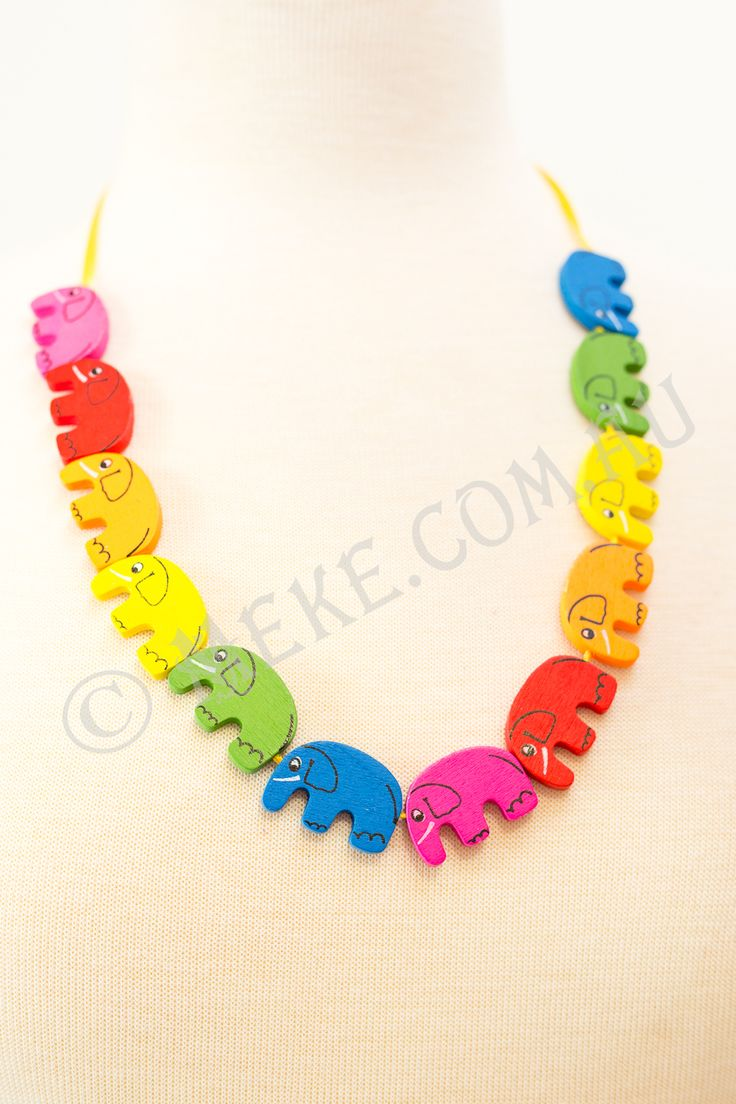 : : Trunk Tales Necklace : :  Your cheeky little monkey will look adorable in this handcrafted children's necklace featuring a bright rainbow of pink, red, orange, yellow, green and blue timber elephant beads parading along a bright yellow ribbon. Who needs the zoo!!!  Visit my Etsy store for more info, or to purchase: https://www.etsy.com/au/listing/153863838/trunk-tales-childrens-necklace-bright?ref=shop_home_active  Handmade with love and care by Marianne ❤