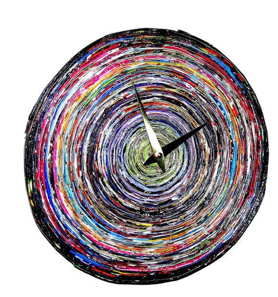 This paper wall clock has every color of the rainbow in it and will brighten any space that you decide to place it. The clock is made from magazine pages that were headed for the recycling bin, so it'