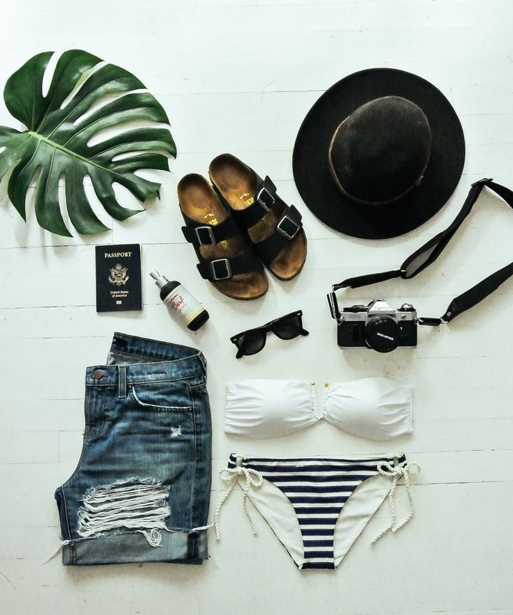 See some of your beach essentials displayed here? Sun hat = a must for us!
