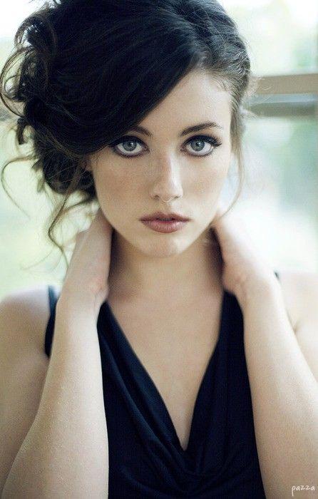 blue eyes, dark hair. Jealous.