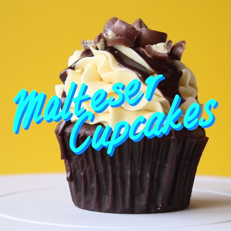 Choc Malt cupcake with malt vanilla frosting, a drizzle of choc sauce and crushed Maltesers on top.