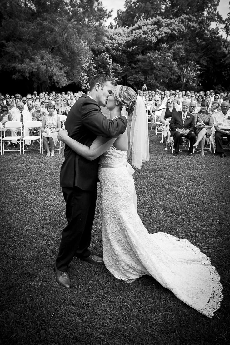 Done only by request, this altar view of the ceremony kiss is priceless! Smithfield wedding photographer Heather Hughes Photography.