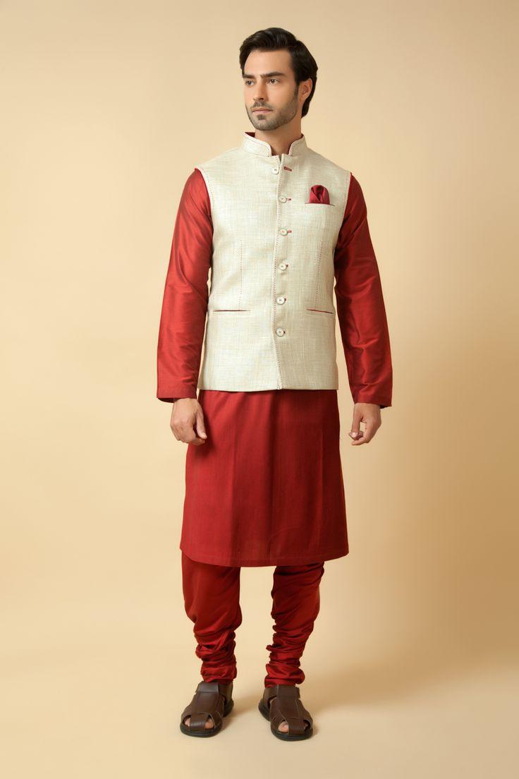 Jute jacket embellished with thread work with plain silk kurta churidar. Item number M15-113