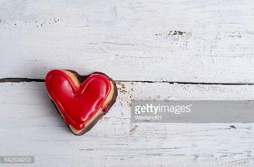 Stock Photo : Heart shaped sponge cake on white wood