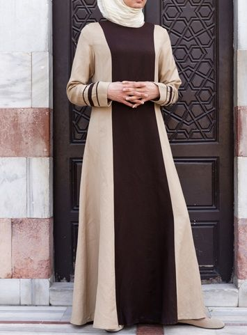 Khalida Dress Dark Chocolate color The Khalida Dress is an Islamic fashion classic if ever there was one. This uniquely designed SHUKR dress is a marriage between high class, modern fashion with its long sleek lines and contrasting color, and understated Islamic modesty. This one won't last long catch yours now before it's gone!
