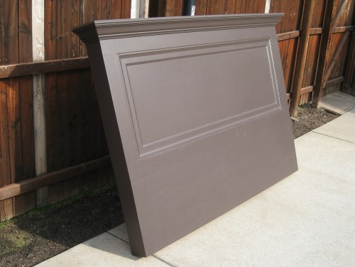 "Painted a Satin Espresso Brown - this Vintage Headboard was made from a 90+ year old door! An extension was added so that the headboard can rest on the floor or with the optional wall bracket can hang on the wall. This old door headboard will fit either a king size or queen size bed. Topped with a 7"" shelf, crown molding, side skirts and decorative trim."