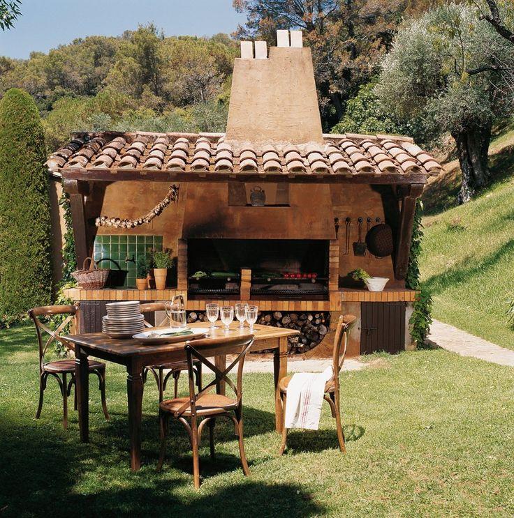 I would love to have this.  a mini outdoor kitchen with olive trees around