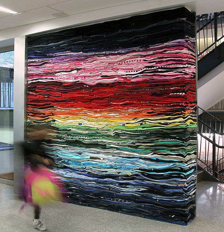 "DERIC MELANDER, Project: ""Into the Fold 2"", installation of folded and stacked second-hand clothing,pinned by Ton van der Veer"