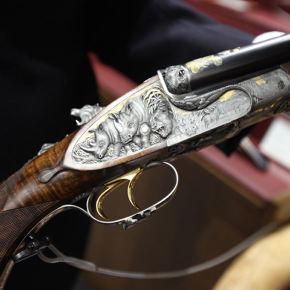 "The right sideplate from Karl Hauptmann's ""African Tribute"" double rifle. Note the deeply chisled ""Germanic"" style of engraving of these rhino. The rifle carries a suggested retail of 450,000 Euro."