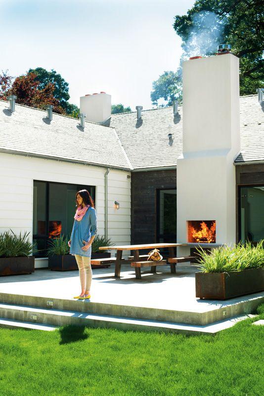 Exterior studio courtyard vibe. . .Outdoor fireplace, mixed exterior materials