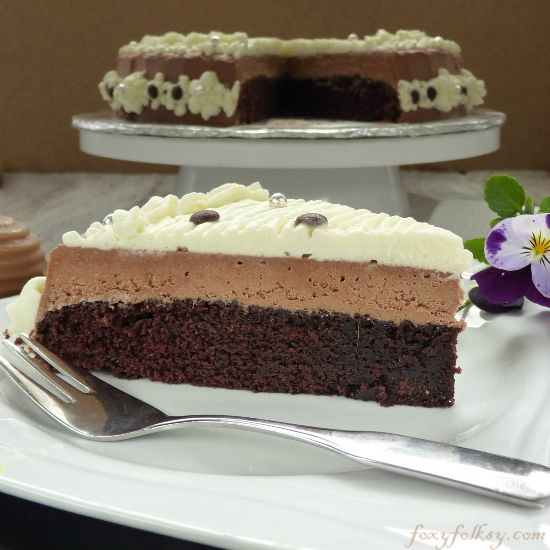 Moist chocolate cake, light and creamy chocolate mousse and topped with whipped cream! Heaven!| www.foxyfolksy.com