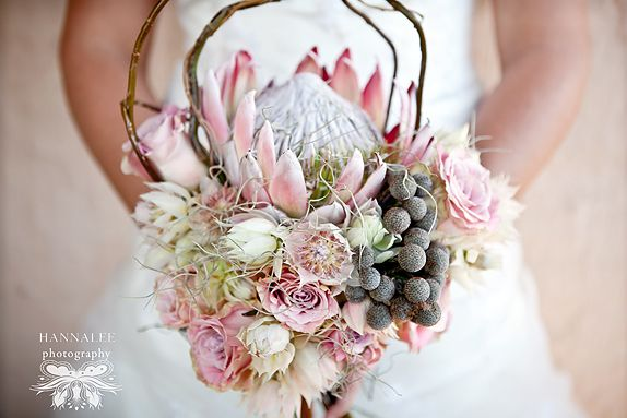 Soft pinks with a touch of silver.  I can only imagine how much this one weighs with that protea