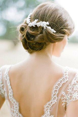 Curled updo with hairpiece | Summer Wedding Hair - Our Top 20 Styles via @onefabday