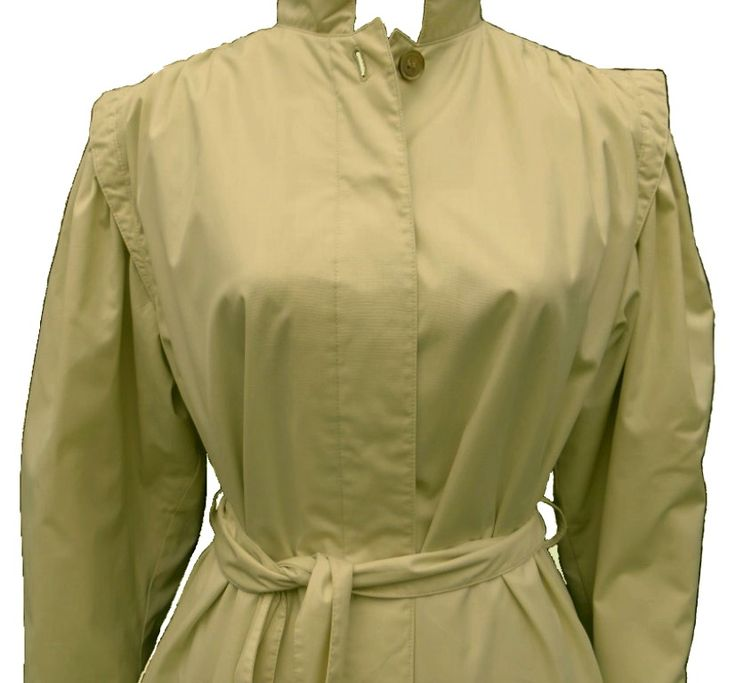 A very soft and feather light Victorian style all weather coat in a rich ivory (model size 36, slim model size 34). Has a classic design, excellent finishes, two pockets, has a belt or can be worn in a straight loose cut, has hidden buttons, a high collar button, boufant sleeve and pleated shoulders and back and a pleated cuff. Excellent condition and very feminine coat from Idem.