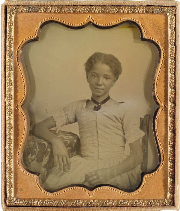 1855 young girl, odd that a child of color  would be photographed in this time era.