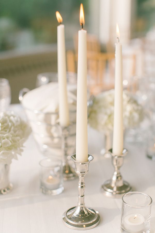 White hydrangeas in silver julep cups, and white candles in silver candlesticks | Snippet  Ink